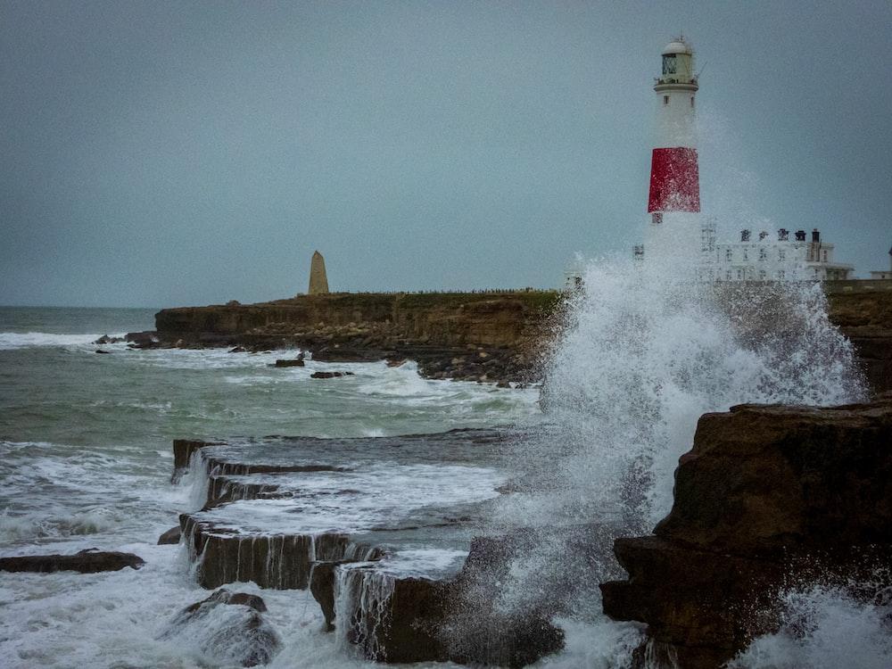 time-lapse photography of waves splashing on seawall