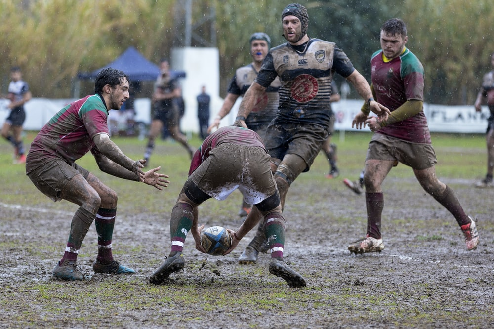 men playing rugby on field