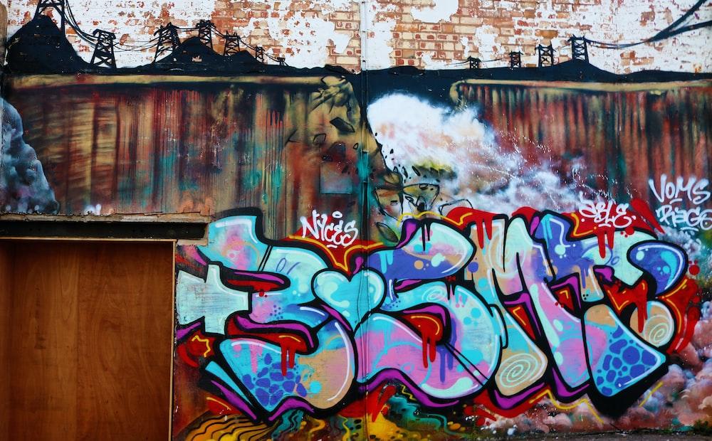 blue and pink graffiti artwork