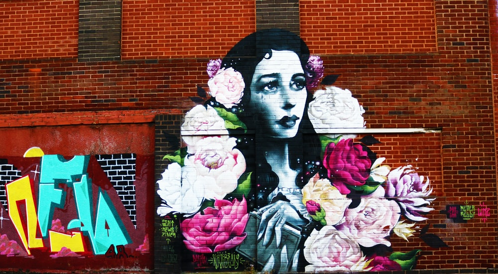 shallow focus photo of woman and flowers wall art