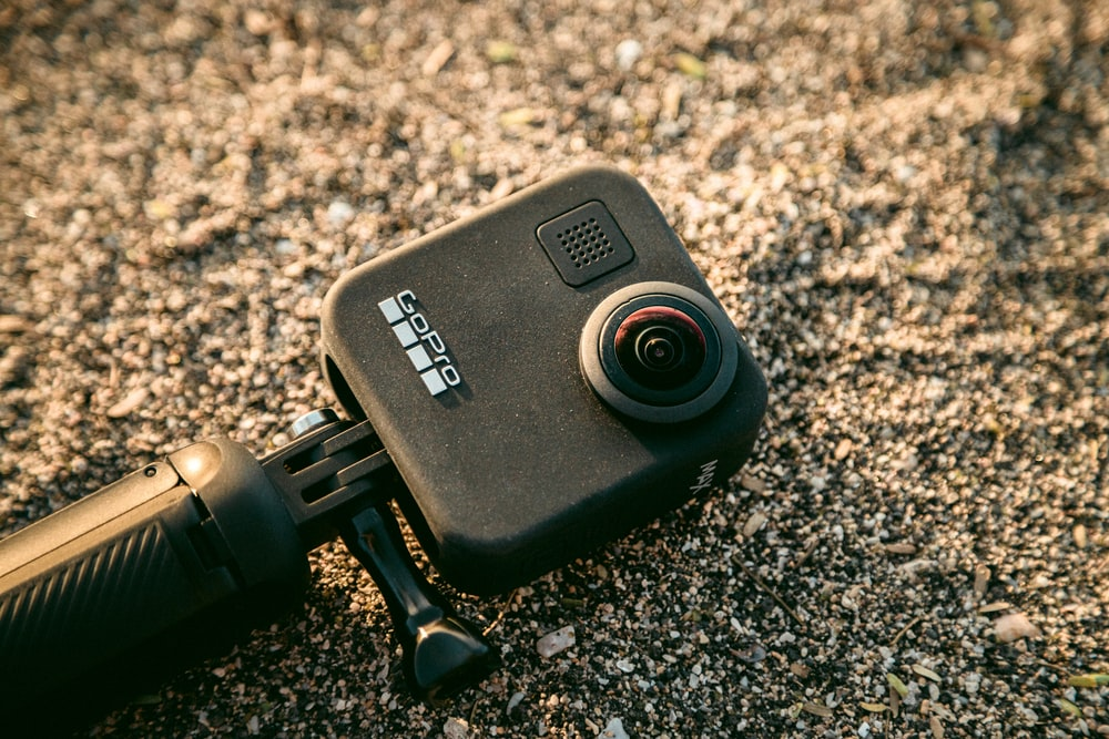 black GoPro action camera in the sand