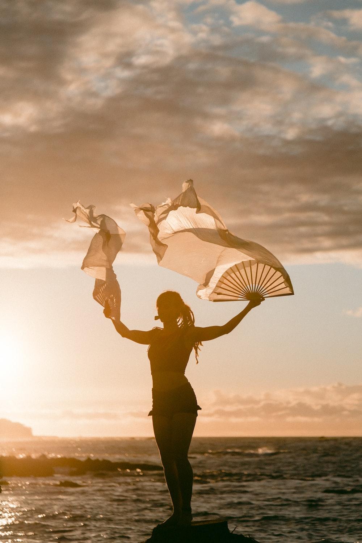 woman waving hand fans