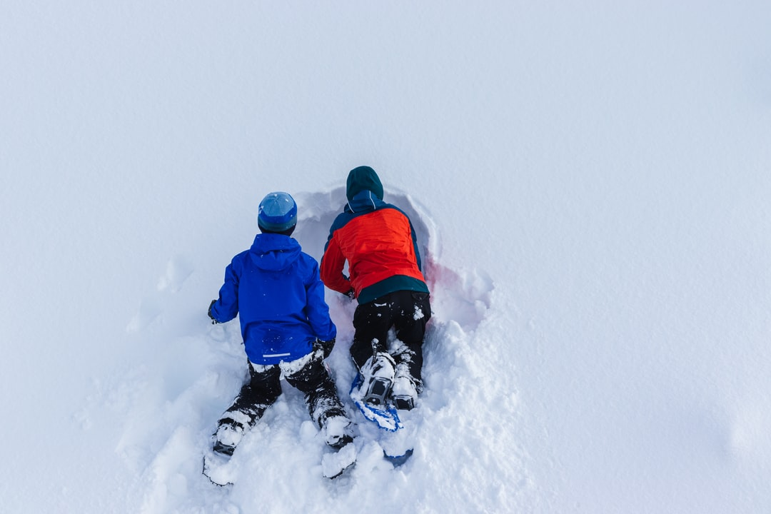 Digging a cave in a snow bank. The possibilities are endless in the snow. It's Canada's sand dunes.