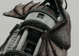 shallow focus photo of dragon on gray building