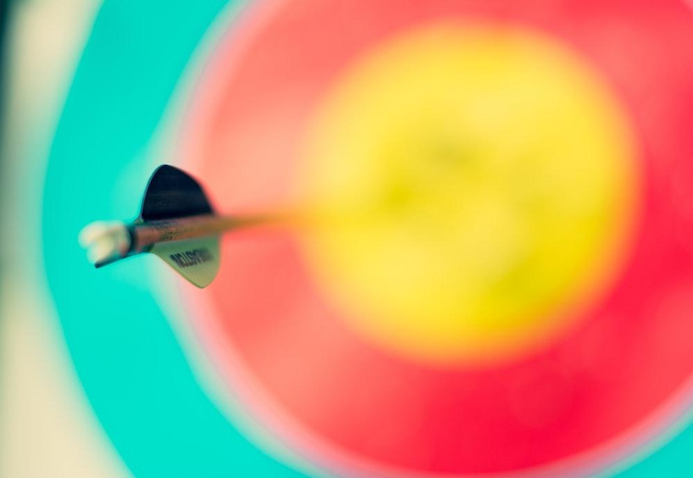 selective focus photography of an arrow