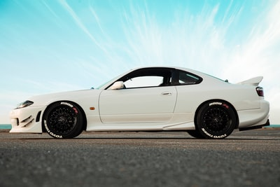 white coupe automobile zoom background