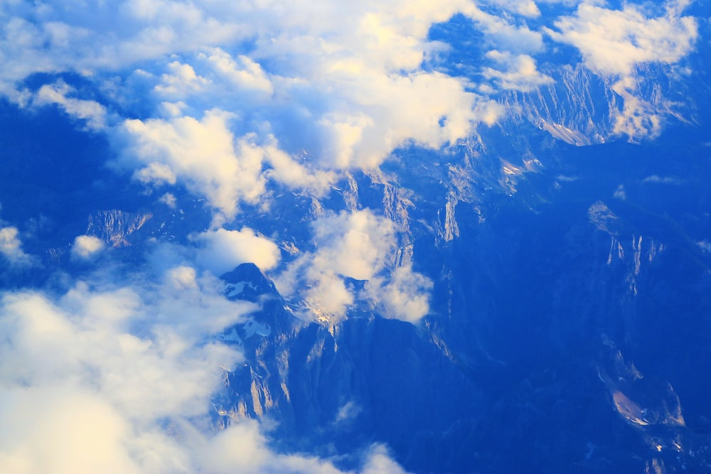 aerial photography of cloud formation and mountain
