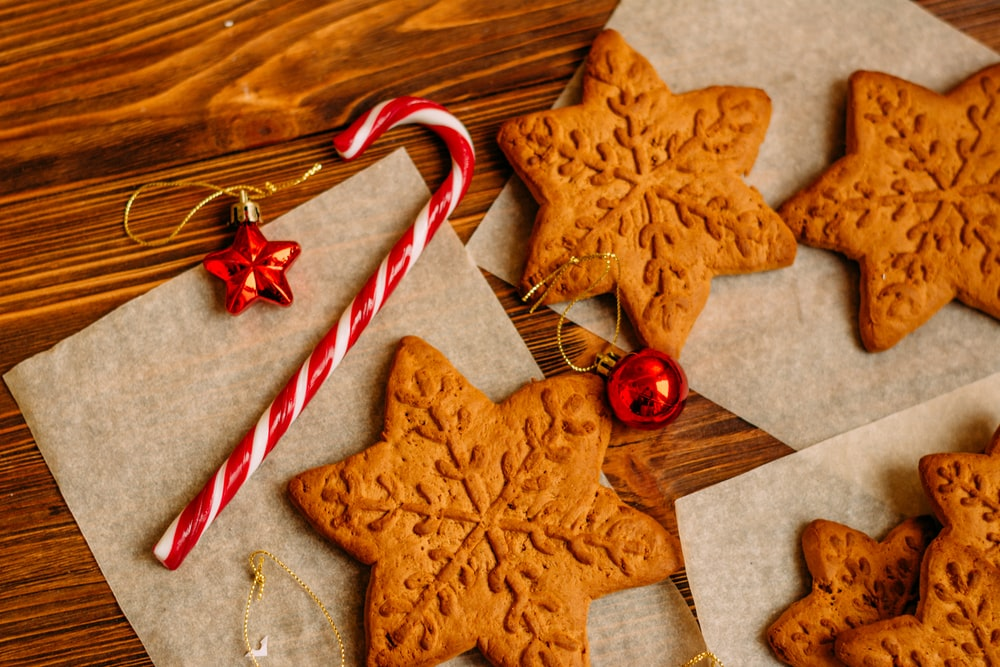 candy cane and cookies on wooden surface