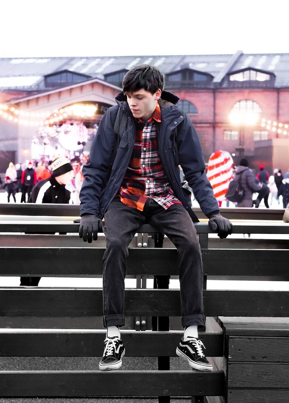 man sitting on a bleacher