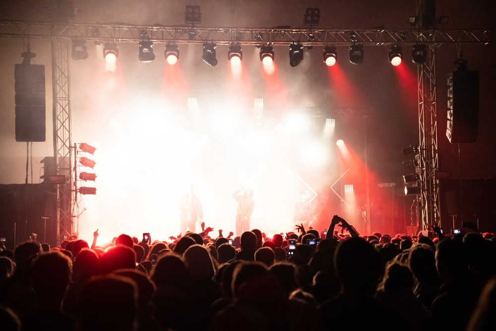 people performing on stage beside people
