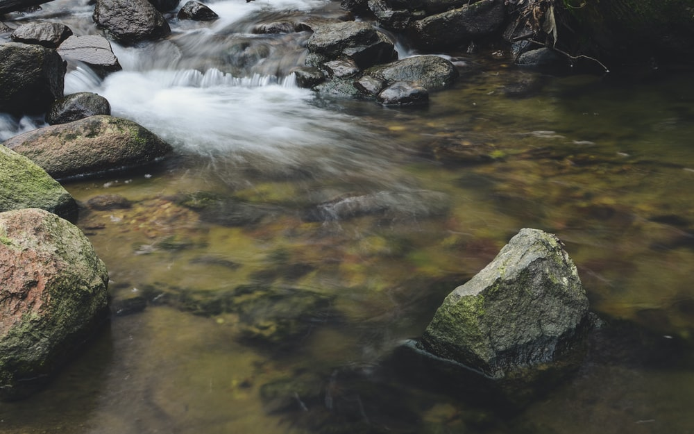 time-lapse photography of flowing waterfall