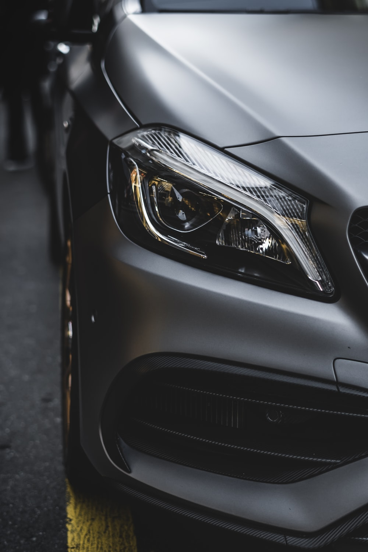shallow focus photo of car headlight