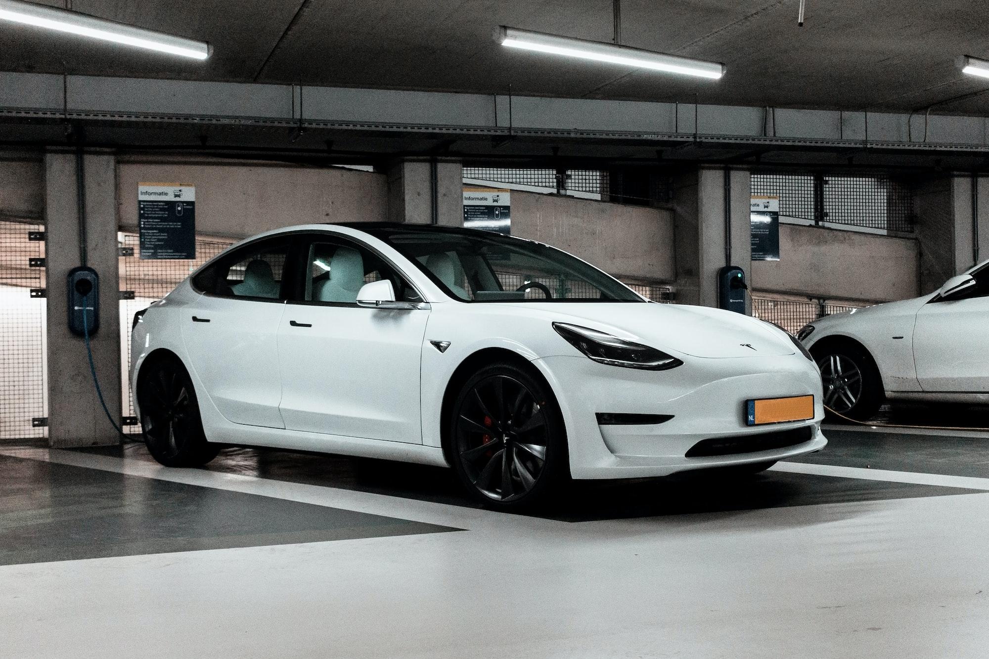 White Tesla charging...
