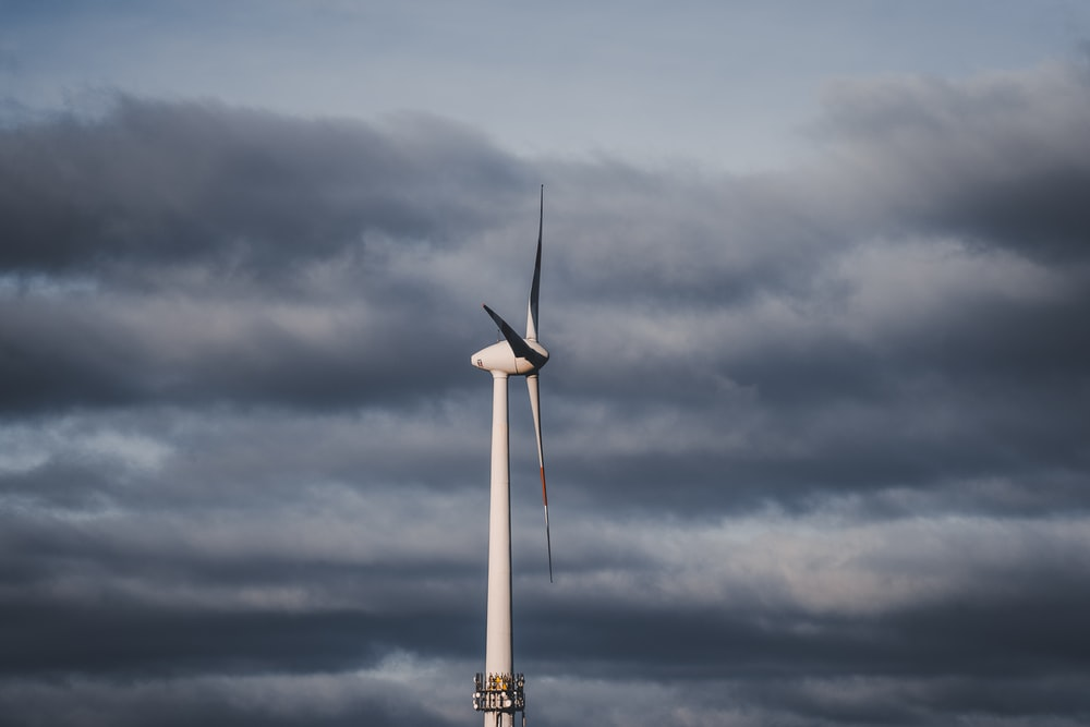 shallow focus photo of white wind turbine