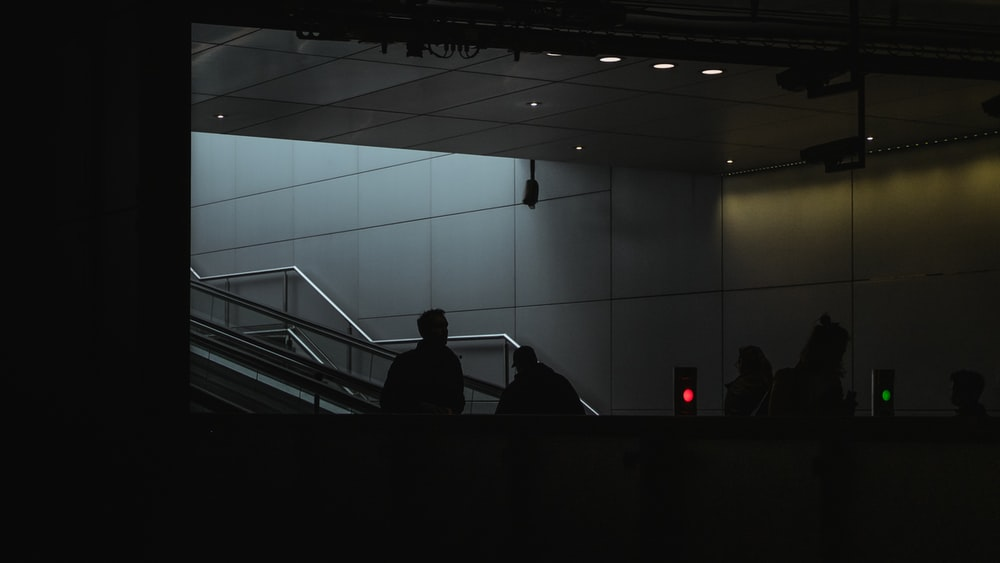 silhouette of people on stairs