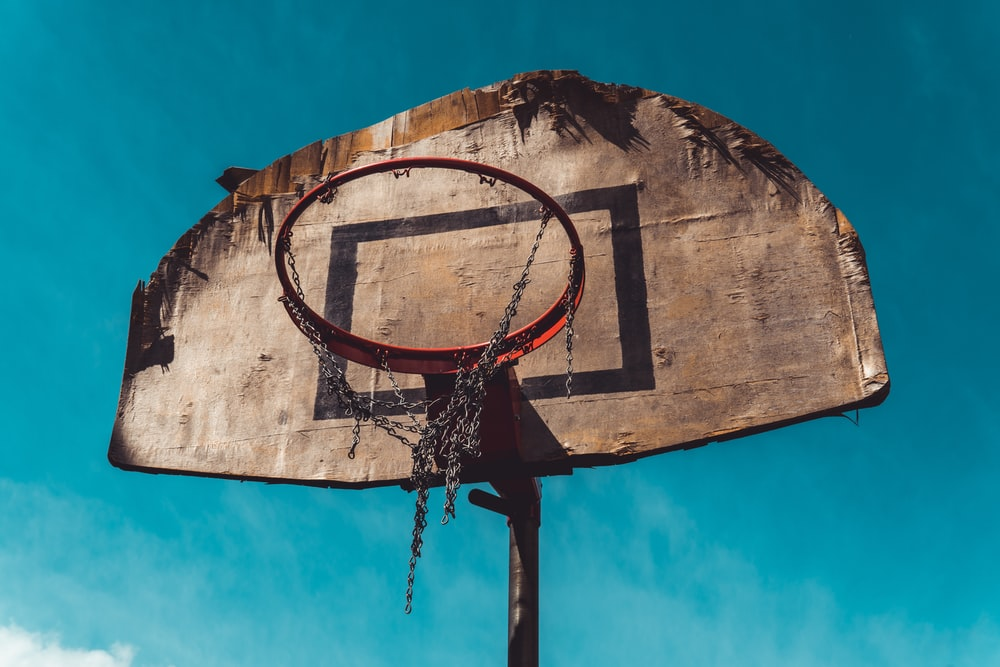 brown and black basketball hoop during day