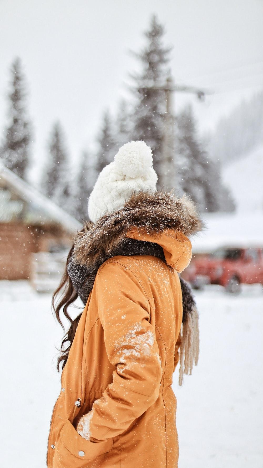 woman wearing brown fur parka coat