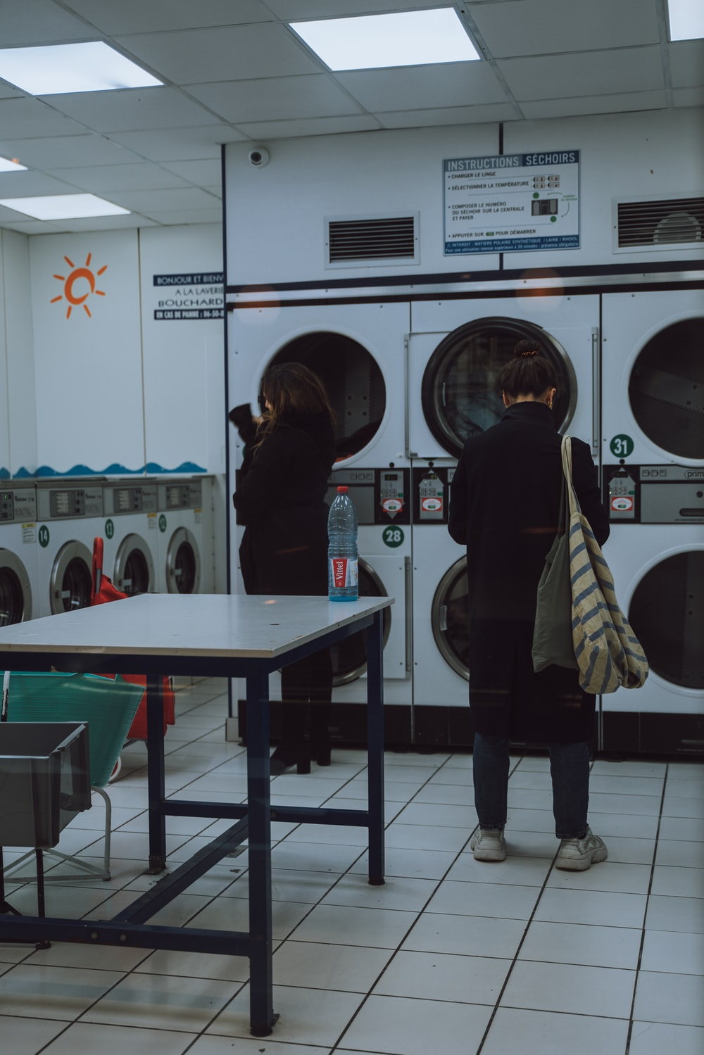 woman standing in front of the front load washer