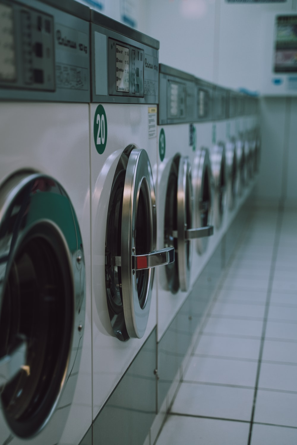 selective focus photography of inline front-load washers