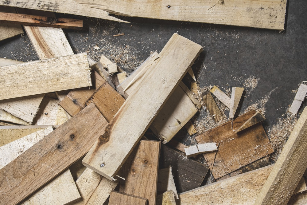 pile of brown wooden planks