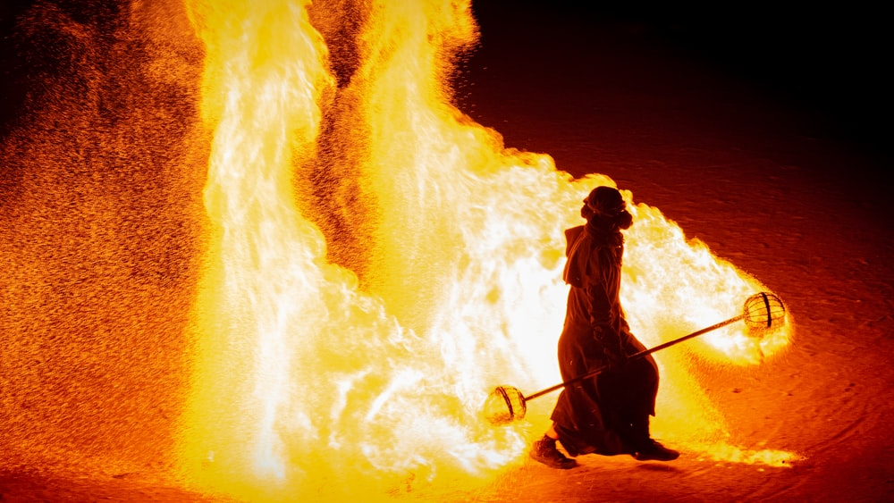 man walking near the fire