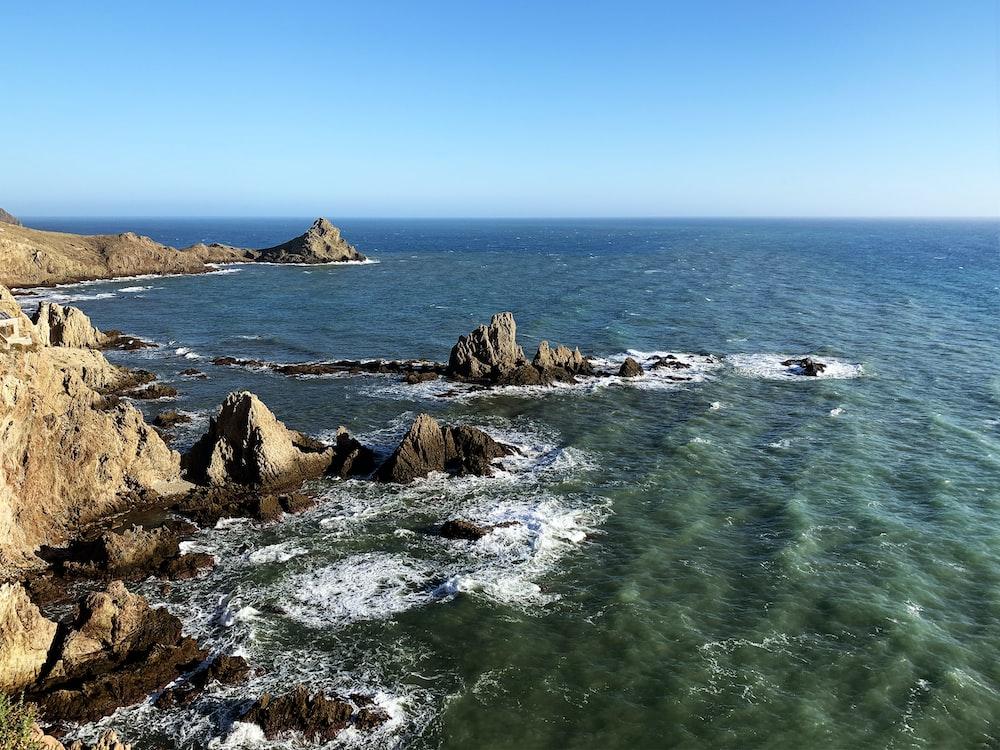 boulders facing ocean