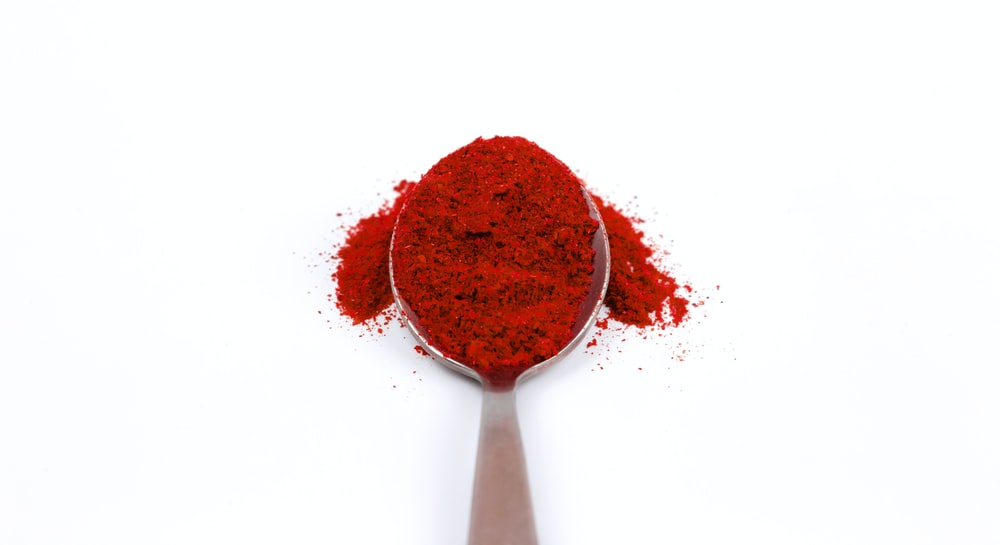 spoon of red powder