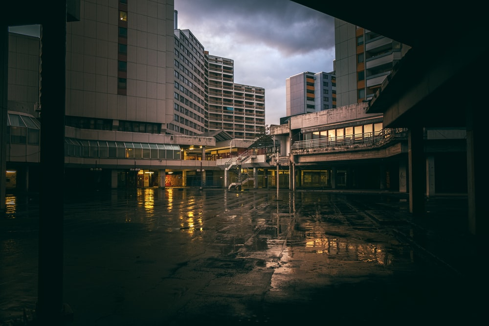 high-rise buildings under heavy clouds