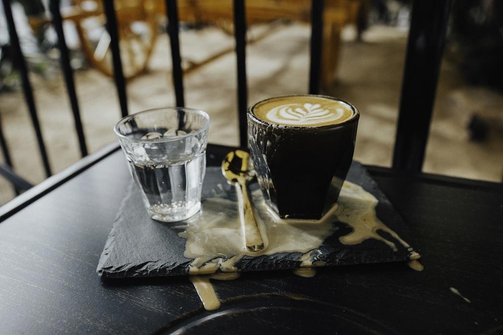 brown liquid in black ceramic mug