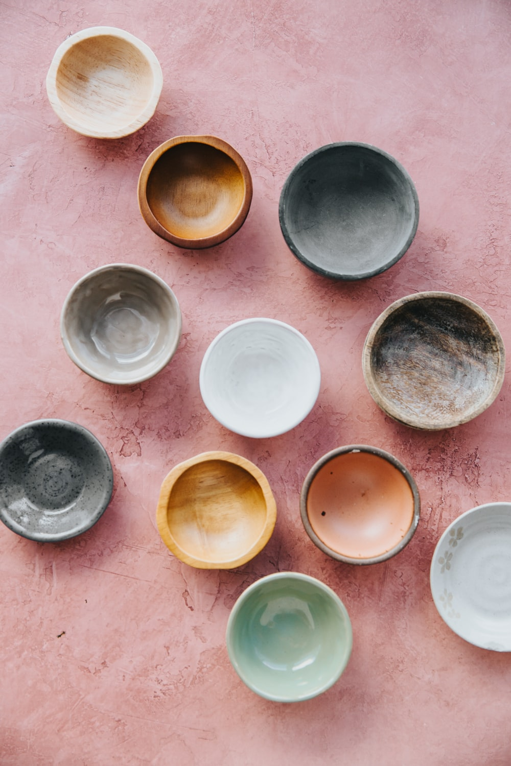 assorted bowls on brown surface