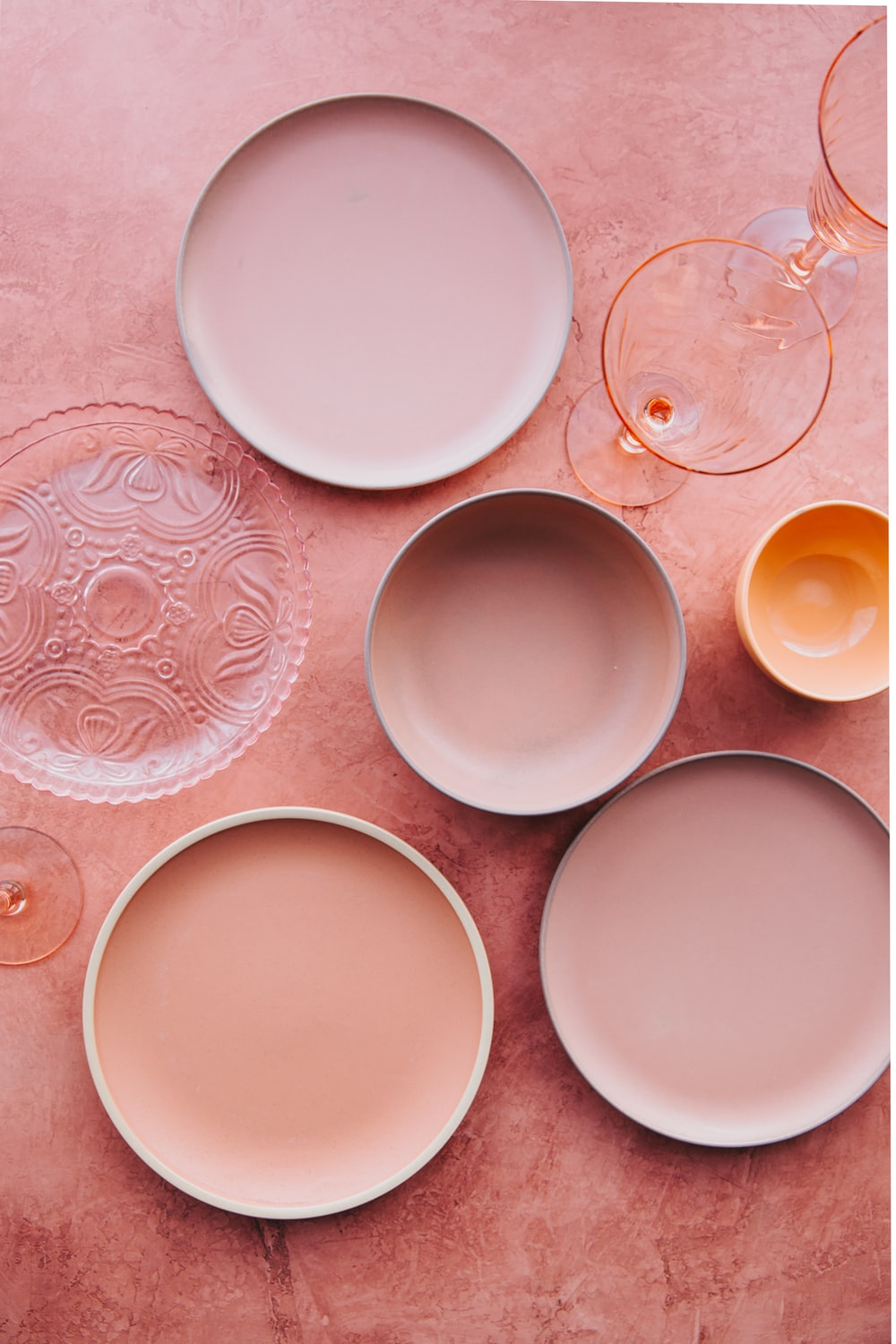 assorted plates on brown surface