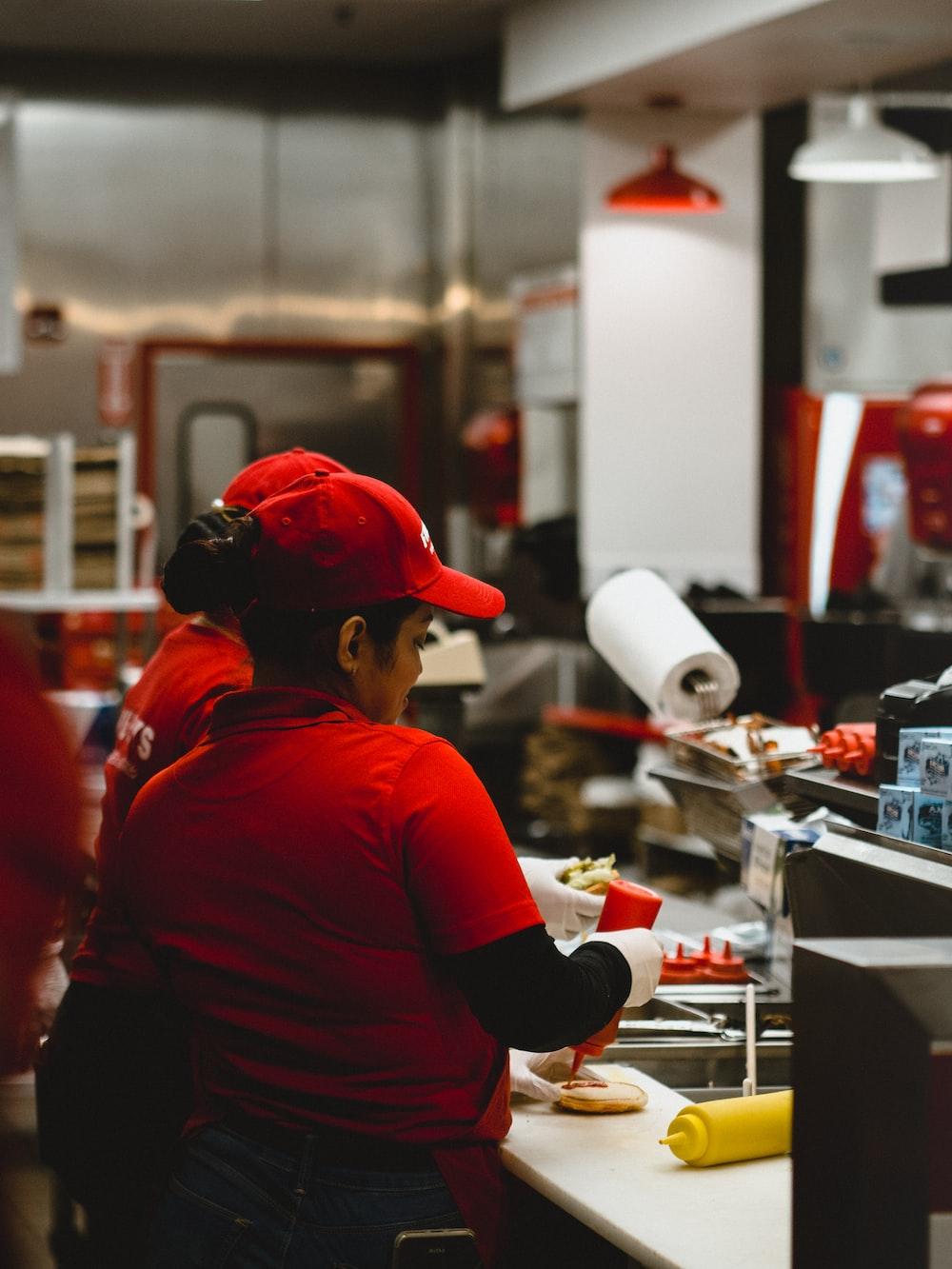 woman in red cap and shirt preparing food