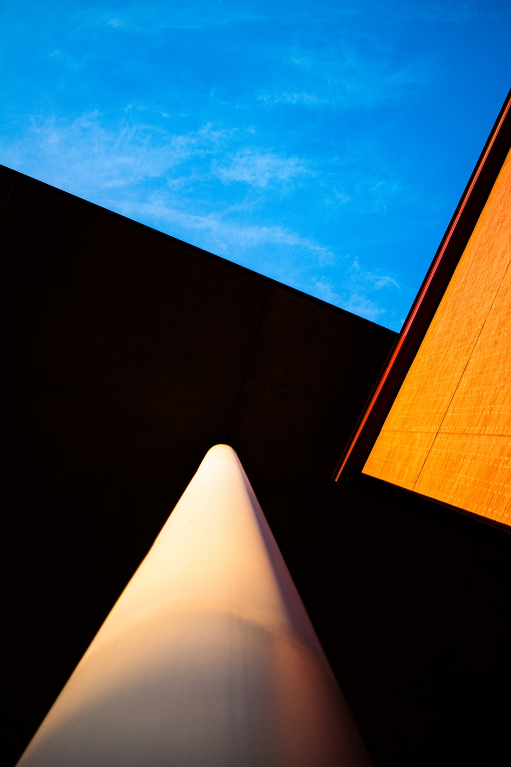 low-angle photo of building under blue sky