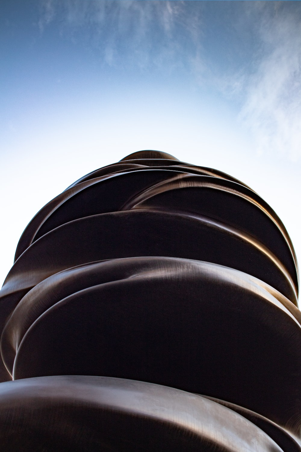 low-angle photography of brown structure under white and blue sky