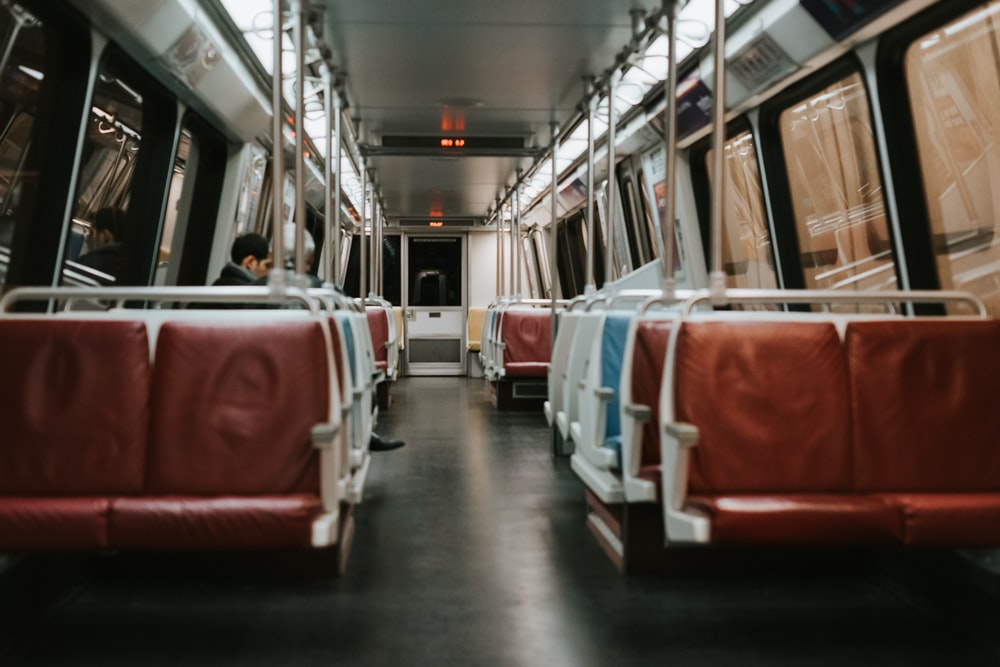 white and brown leather train benches