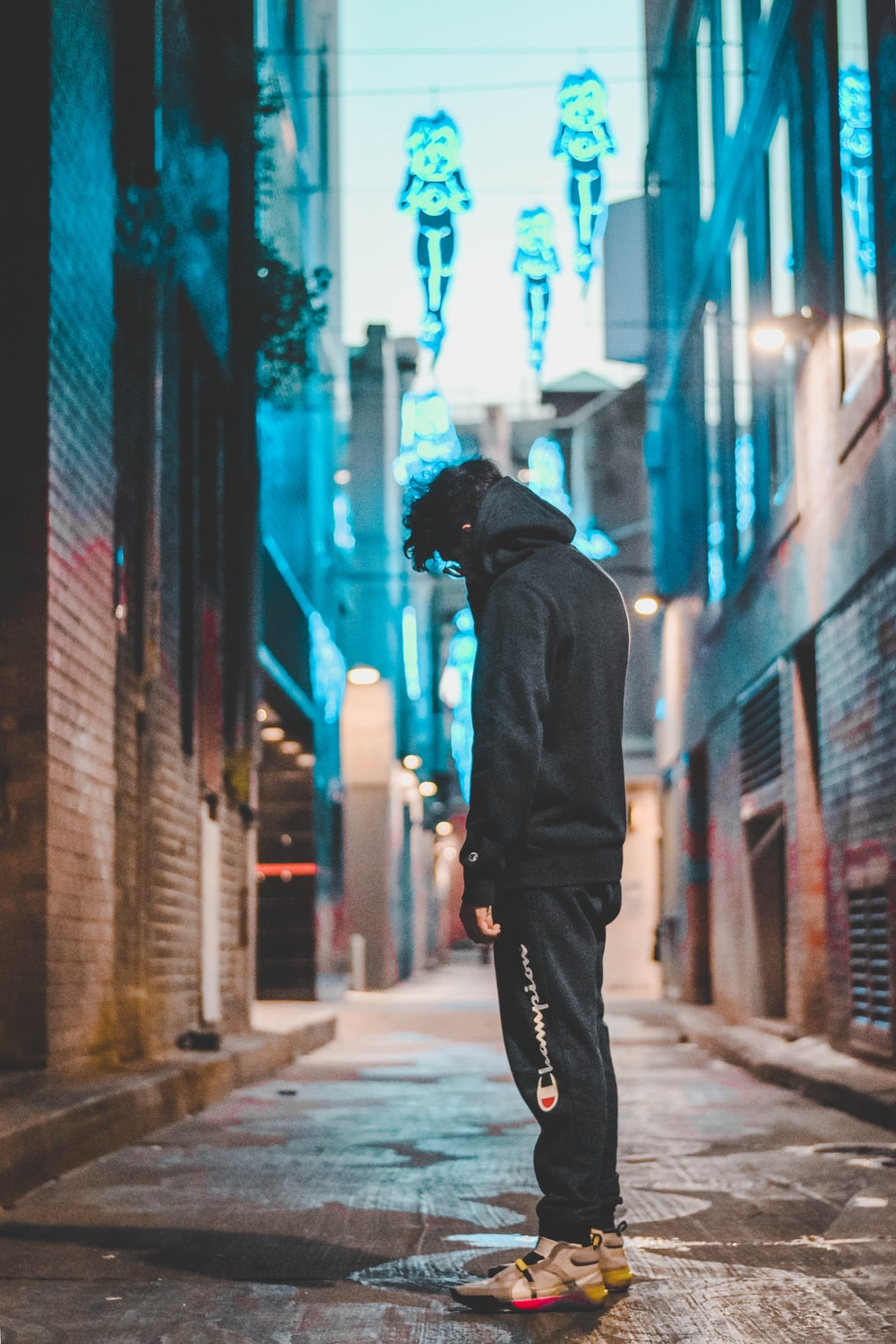 man standing in the middle of the alley