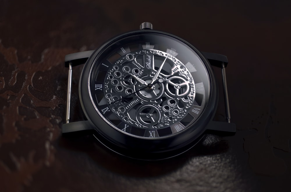 round black and gray skeletal watch
