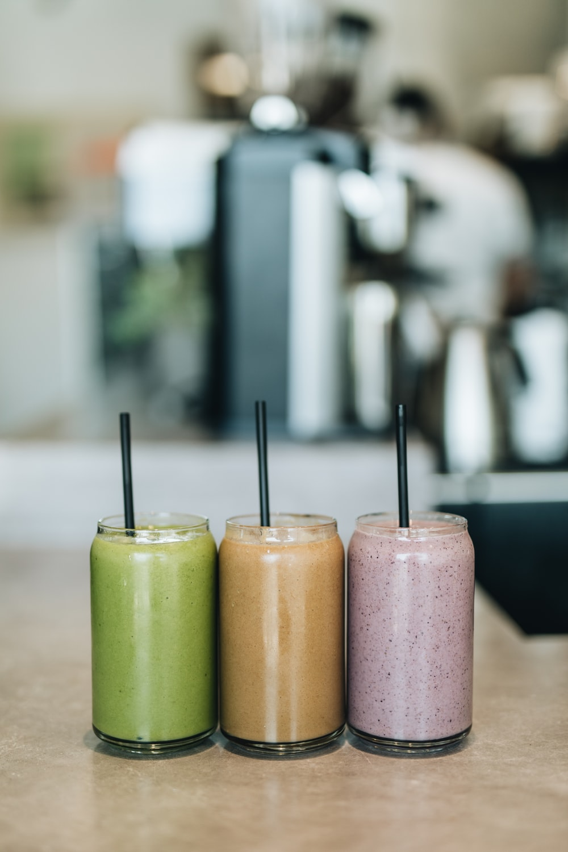 three drinks on gray surface