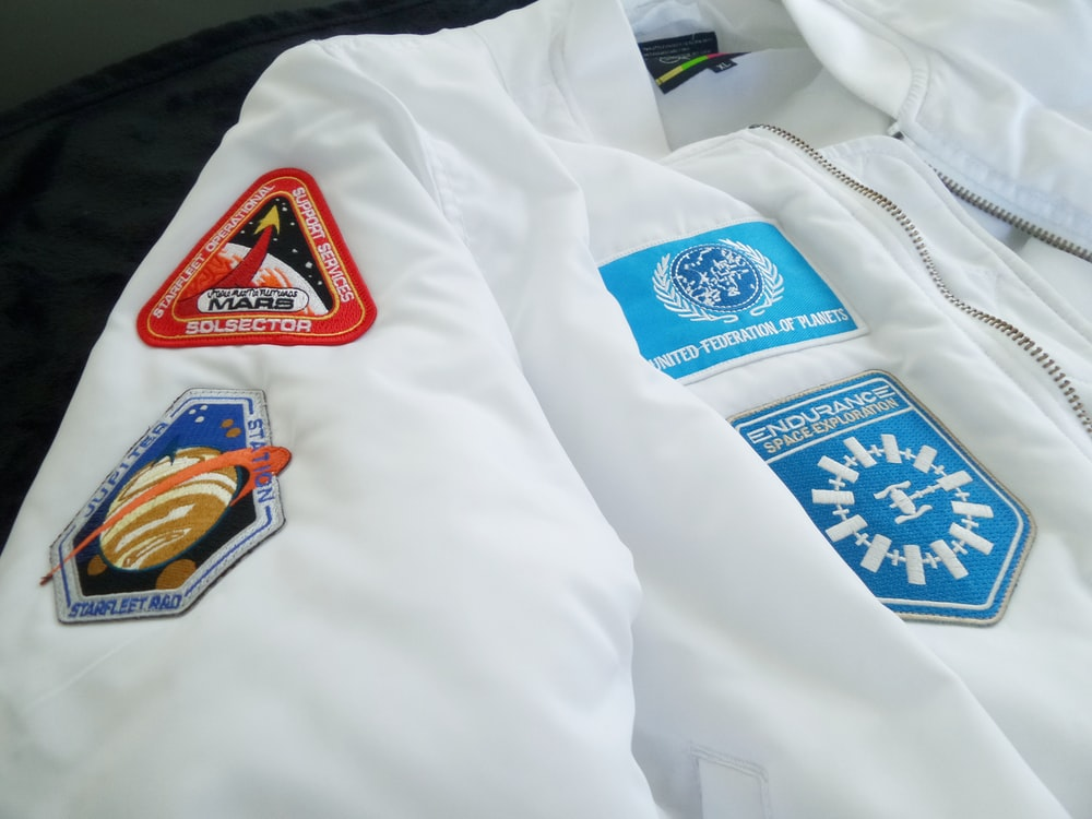 white jacket with blue patches