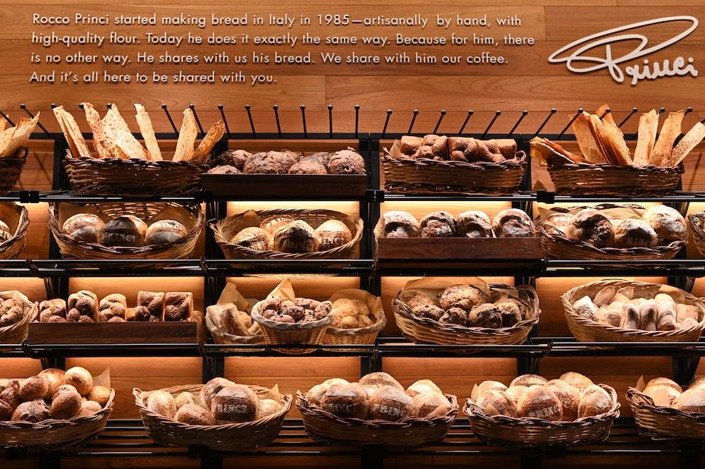 assorted bread in wicker baskets