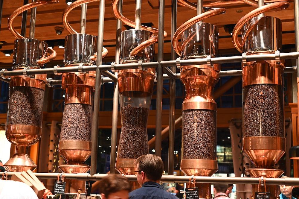 copper-colored coffee dispensers