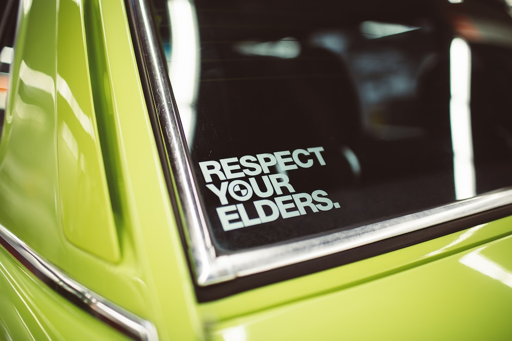 respect your elders sign on car window