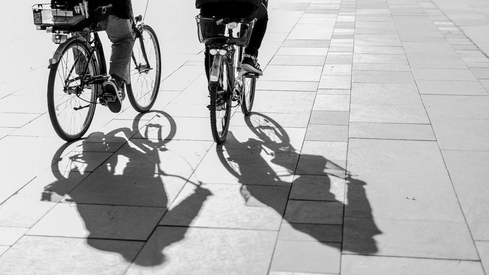 grayscape photo of person riding bike