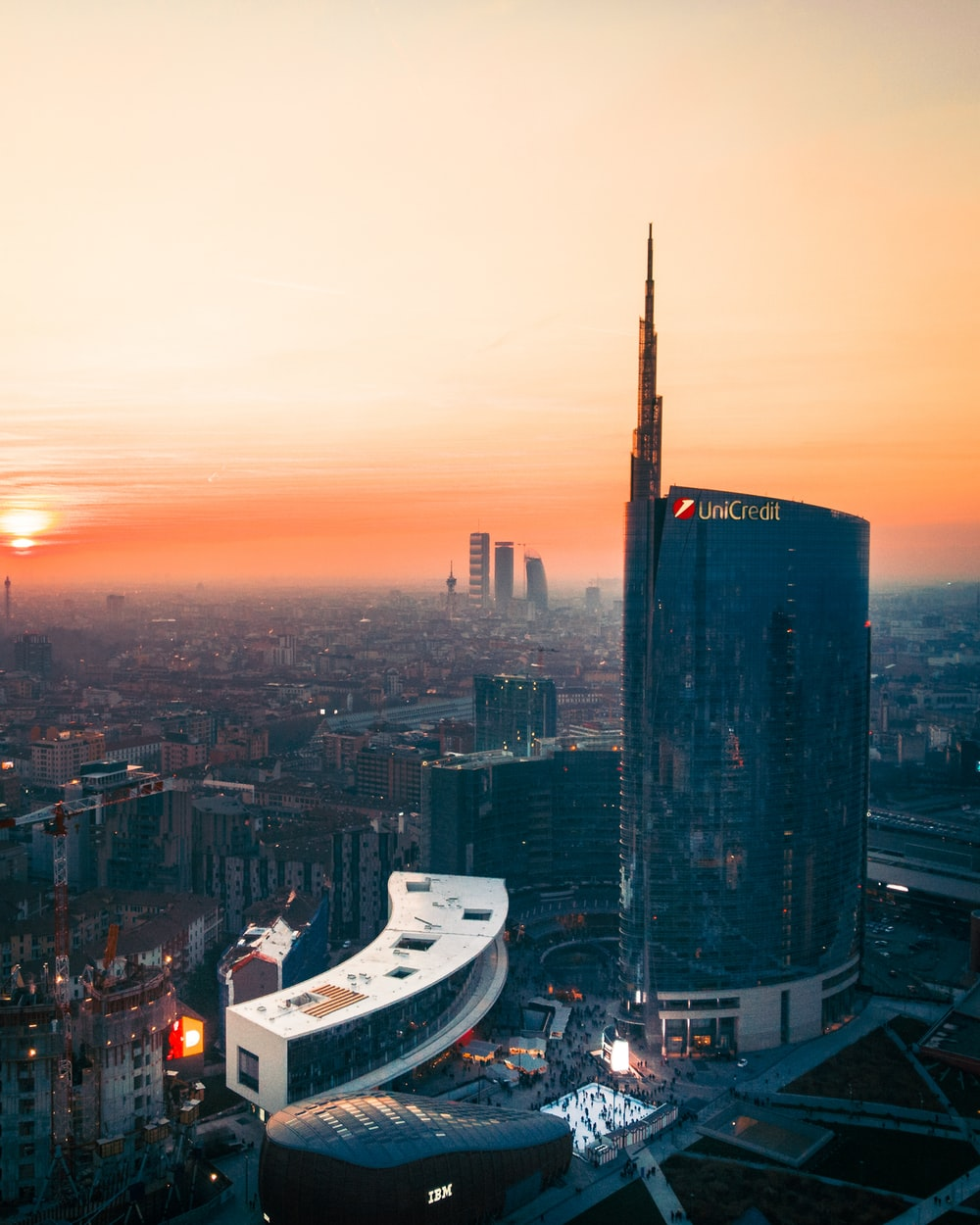 aerial photography of city with high-rise buildings under orange sky