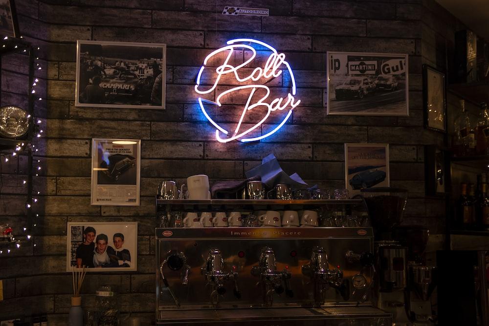 Roll bar neonlight beside ceramic ware lot