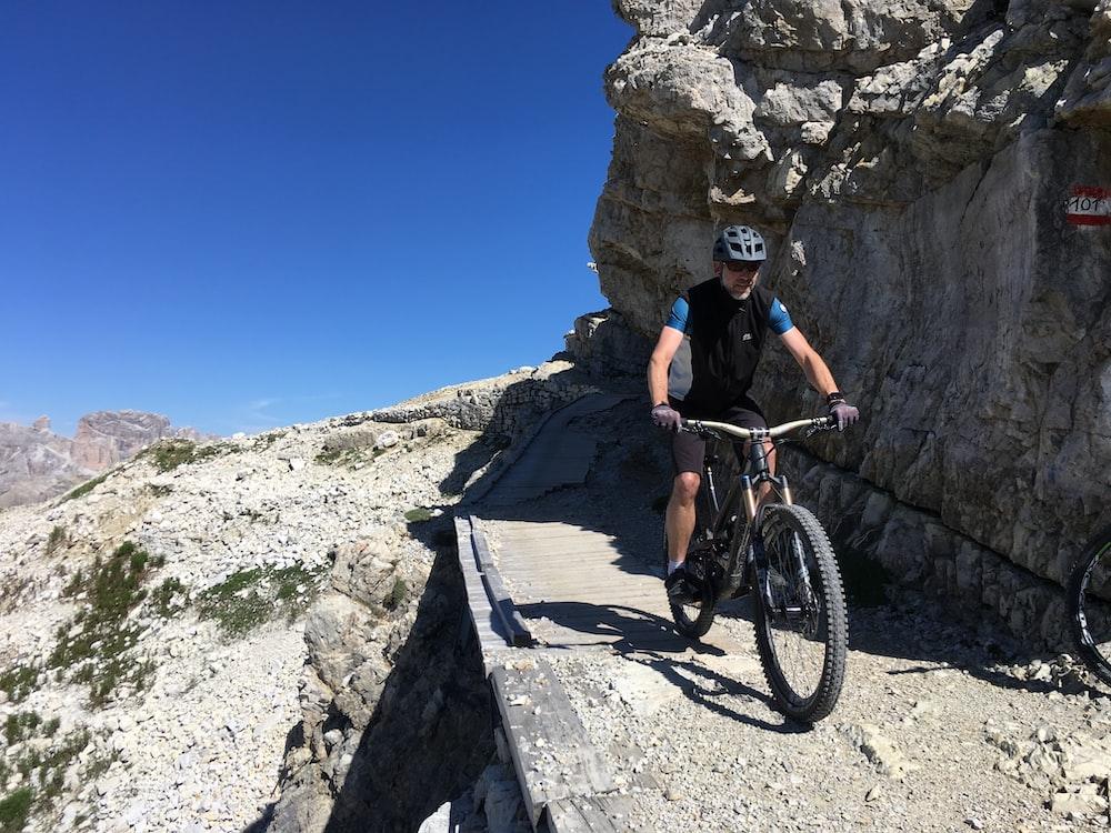 man riding bicycle photograph