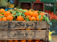 wooden crate filled with orange fruits