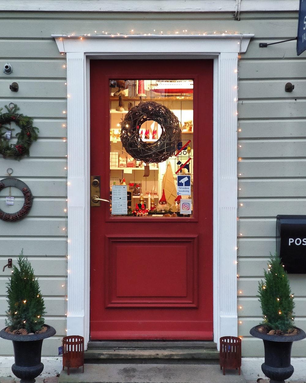 red wooden storm glass door