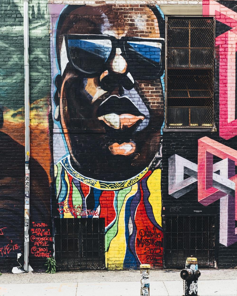 man wearing black sunglasses wall painting