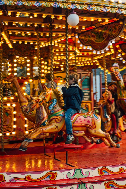 children riding merry-go-round